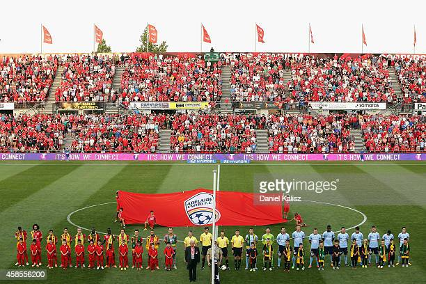 Players and fans pause for a minutes silence prior to the round five A-League match between Adelaide United and Sydney FC at Coopers Stadium on...