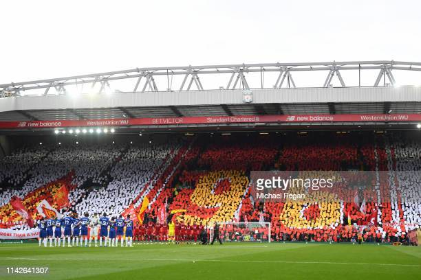 Players and fans pay their respects for the upcoming 30th anniversary of the Hillsborough tragedy prior to the Premier League match between Liverpool...