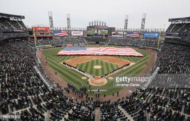 Players and fans stand during the National Anthem before the Opening Day home game between the Chicago White Sox and the Detroit Tigers at Guaranteed...