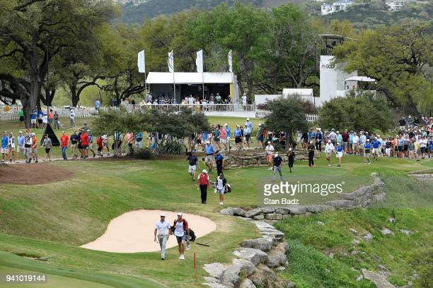 Players and fans walk along the 17th hole during round three of the World Golf ChampionshipsDell Technologies Match Play at Austin Country Club on...