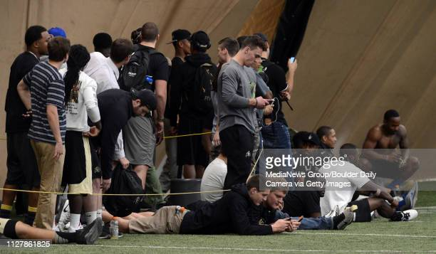 Players and fans watch the player run their drills Former University of Colorado football players and others showed their skills at the CU pro timing...