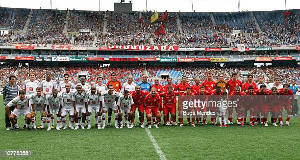 Players and friends of Zico pose for a photograph before the Jogo das Estrelas Charity Soccer Match between CR Flamengo Stars and Friends of former...