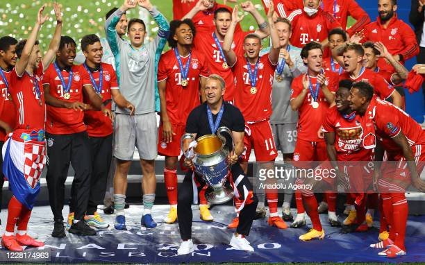 Players and head coach Hans-Dieter Flick of Bayern Munich celebrate at the end of the UEFA Champions League final football match between Paris...