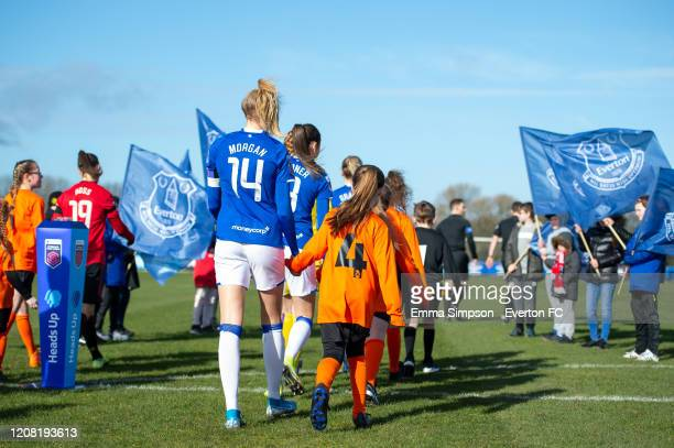 Players and mascots walk onto the pitch prior to the Barclays FA Women's Super League match between Everton and Manchester United at Walton Hall Park...