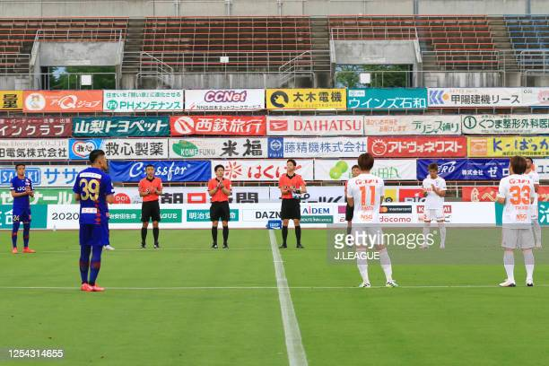 Players and match officials applaud medical workers prior to the J.League Meiji Yasuda J2 match between Ventforet Kofu and Albirex Niigata at the...
