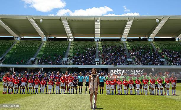 Players and match officials line up for the singing of the Australian national anthem during the WLeague Grand Final match between Perth and Canberra...