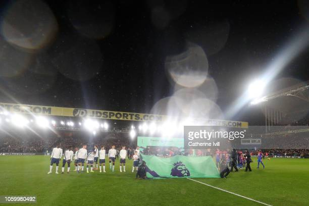 Players and match officials line up prior to the Premier League match between Crystal Palace and Tottenham Hotspur at Selhurst Park on November 10...