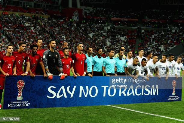 Players and match officials line up with an anti racism banner prior to the FIFA Confederations Cup Russia 2017 SemiFinal between Portugal and Chile...