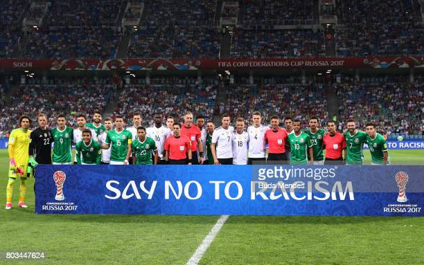 Players and match officials stand with an anti racism banner prior to the FIFA Confederations Cup Russia 2017 SemiFinal between Germany and Mexico at...