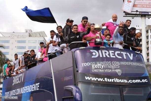 Players and members of Ecuadorean football team Independiente del Valle celebrate on the bus during a welcoming caravan through Quito on November 10...