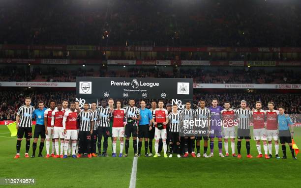 Players and officials line up as part of the No Room for Racism campaign prior to the Premier League match between Arsenal FC and Newcastle United at...