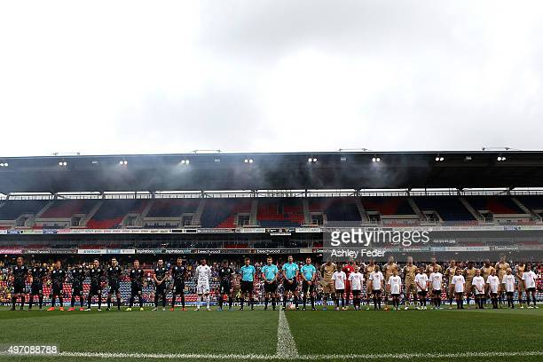Players and Officials line up for a one minute silence over the terrorist attacks in Paris during the round six ALeague match between the Newcastle...