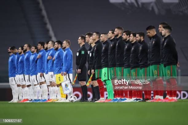 Players and officials line up for the Natioanl anthems prior to the FIFA World Cup 2022 Qatar qualifying match between Portugal and Azerbaijan at...