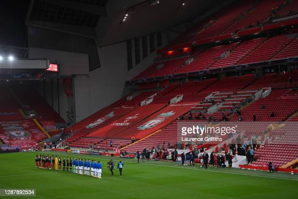 Players and Officials line up in front of empty stands ahead of the UEFA Champions League Group D stage match between Liverpool FC and Atalanta BC at...