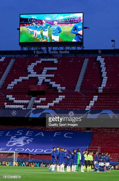 Players and Officials line up in front of empty stands ahead of the UEFA Champions League Quarter Final Second Leg match between Chelsea FC and FC...