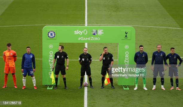 Players and officials line up on the field prior to the Premier League match between Tottenham Hotspur and Chelsea at Tottenham Hotspur Stadium on...