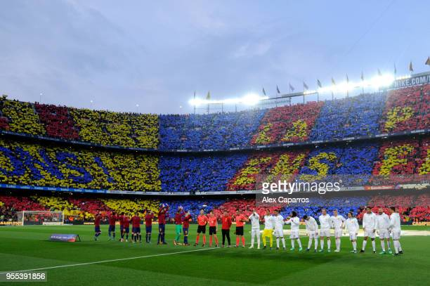 Players and officials line up prior to the La Liga match between Barcelona and Real Madrid at Camp Nou on May 6 2018 in Barcelona Spain