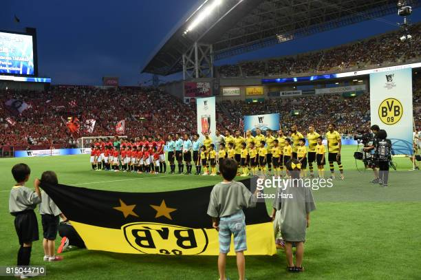 Players and officials line up prior to the preseason friendly match between Urawa Red Diamonds and Borussia Dortmund at Saitama Stadium on July 15...