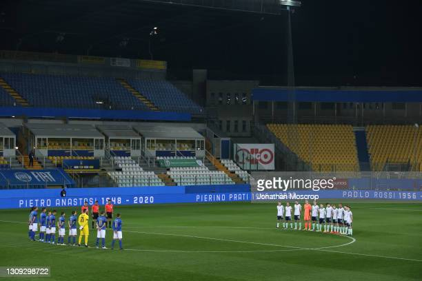Players and officials line up to observe a minute's silence in memory of former Italian National team members Pietro Anastasi, Pierino Prati, Paolo...