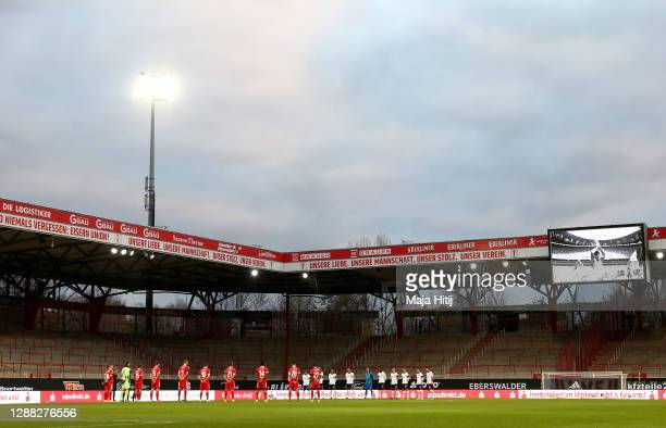 Players and Officials observe a minute of silence in memory of Diego Maradona prior to kick off during the Bundesliga match between 1. FC Union...