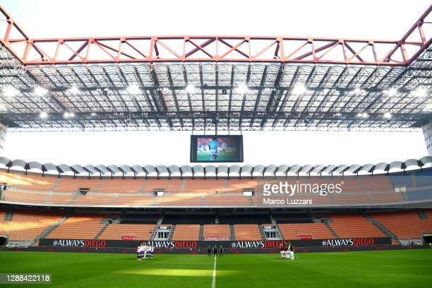 Players and Officials observe a minute of silence in memory of Diego Maradona prior to during the Serie A match between AC Milan and ACF Fiorentina...