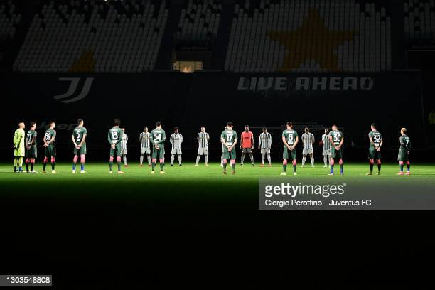 Players and officials observe a minute of silence in memory of ex Italian defender Mauro Bellugi during the Serie A match between Juventus and FC...