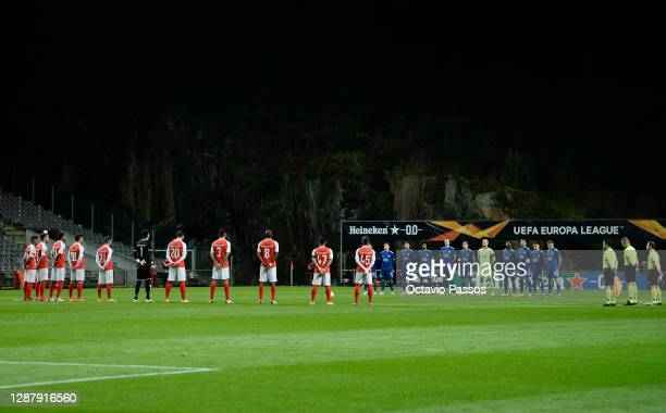 Players and Officials observe a minute of silence prior to kick off in memory of Diego Maradona during the UEFA Europa League Group G stage match...