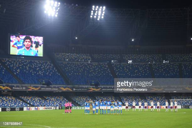 Players and Officials observe a minute of silence prior to kick off wearing number 10 on their shirts in memory of Diego Maradona during the UEFA...