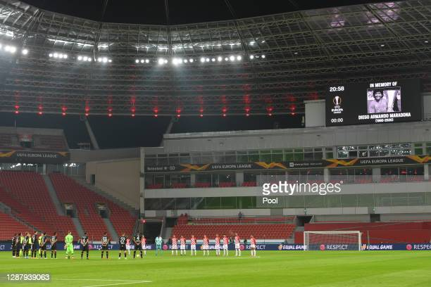 Players and Officials observe a minute of silence prior to kick off in memory of Diego Maradona during the UEFA Europa League Group C stage match...