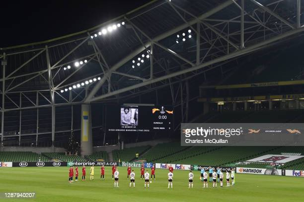 Players and Officials observe a minute of silence prior to kick off in memory of Diego Maradona during the UEFA Europa League Group B stage match...