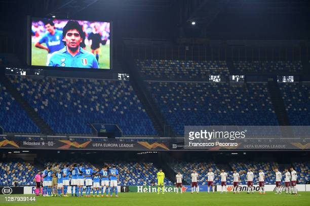 Players and Officials observe a minute of silence wearing number 10 on their shirts prior to kick off in memory of Diego Maradona while wearing a...