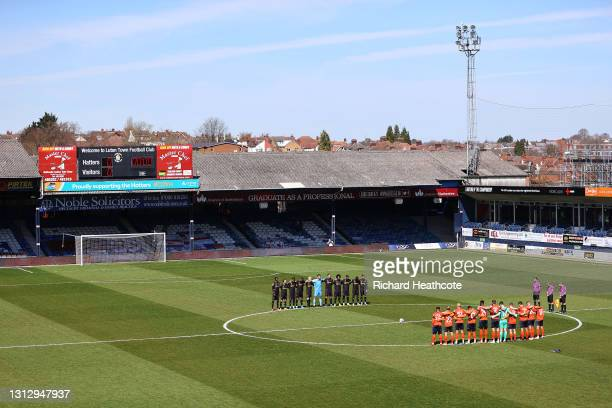 Players and Officials observe two minutes of silence prior to kick off in memory of Prince Philip, Duke of Edinburgh during the Sky Bet Championship...