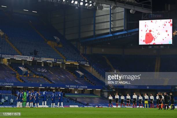 Players and officials observe two minutes silence, part of Remembrance Day commemorations, ahead of the English Premier League football match between...