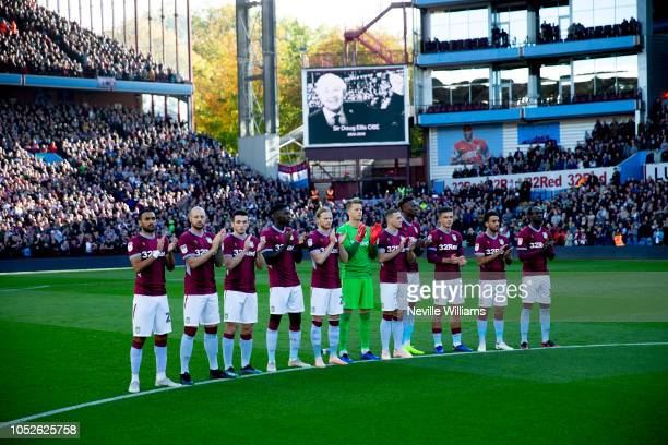Players and Officials of Aston Villa and Swansea take part in a minutes applause for former Aston Villa chairman Sir Doug Ellis before the Sky Bet...