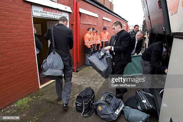 Players and officials of Boston United unloading kit from their team bus prior to the Blue Square North fixture between hosts Workington AFC and...