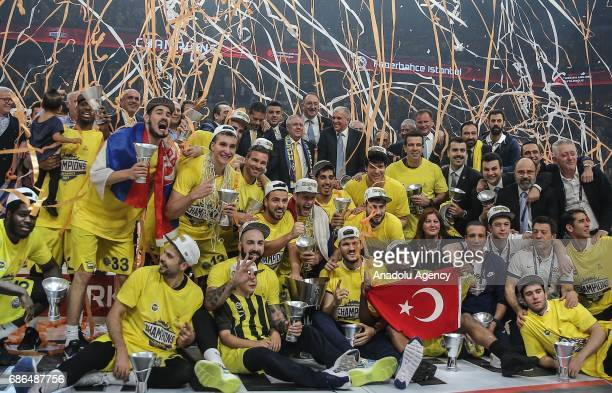 Players and officials of Fenerbahce celebrate their victory as they received the cup in Turkish Airlines Euroleague Final Four championship after the...