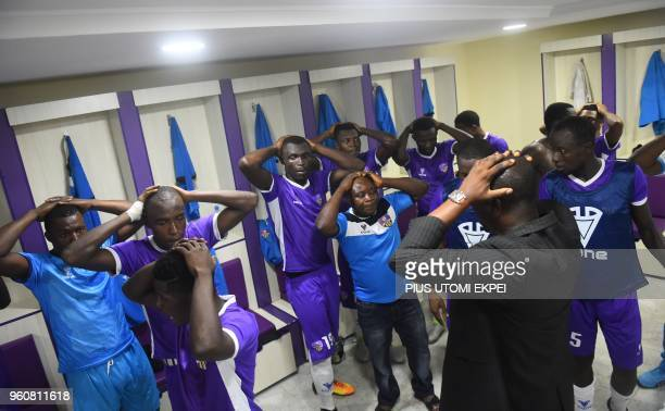 Players and officials of Mountain of Fire and Miracles Ministries football club pray in the changing room before a continental match at Agege Stadium...