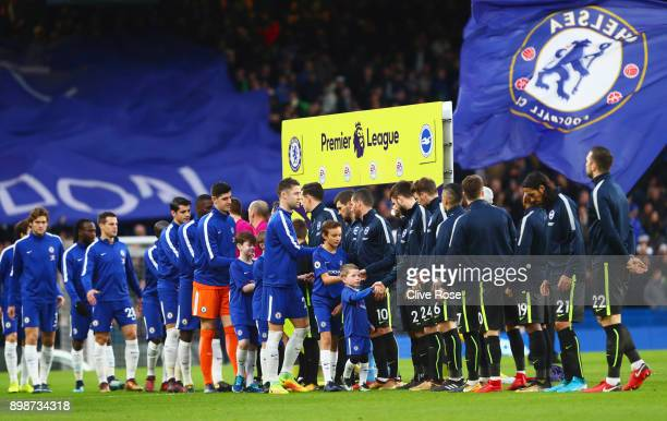 Players and officials shake hands prior to the Premier League match between Chelsea and Brighton and Hove Albion at Stamford Bridge on December 26...