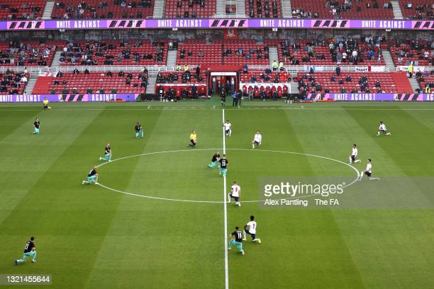 Players and officials take a knee in support of the black lives matter movement during the international friendly match between England and Austria...