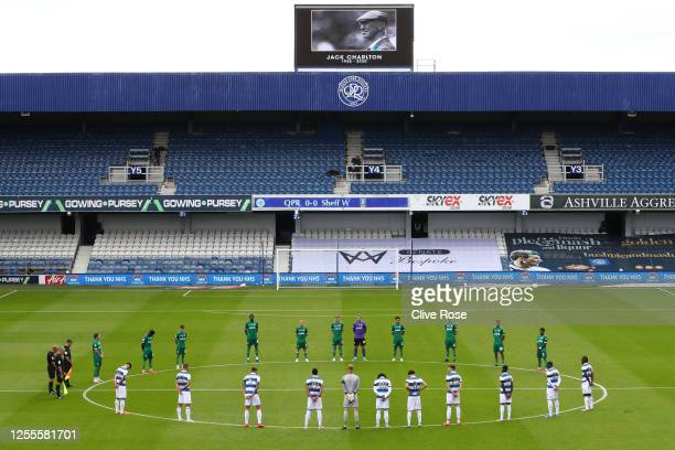 Players and officials take part in a minute of silence to pay tribute to Jack Charlton prior to the Sky Bet Championship match between Queens Park...
