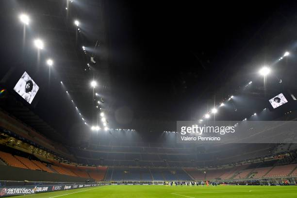 Players and officials take part in a minute of silence to remember Diego Maradona prior to the UEFA Champions League Group B stage match between FC...
