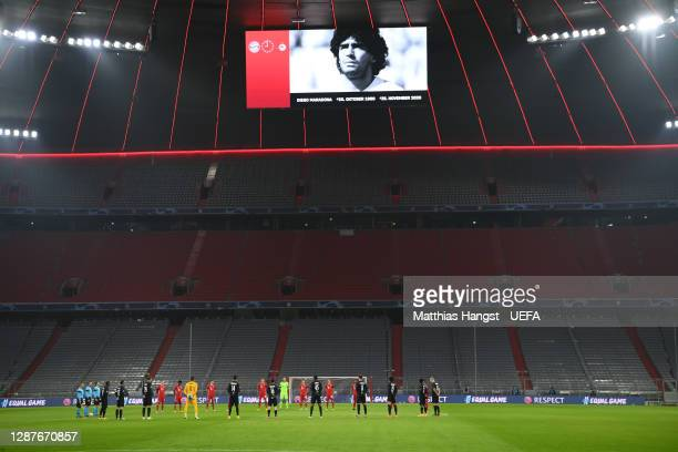 Players and officials take part in a minute of silence to remember Diego Maradona prior to the UEFA Champions League Group A stage match between FC...