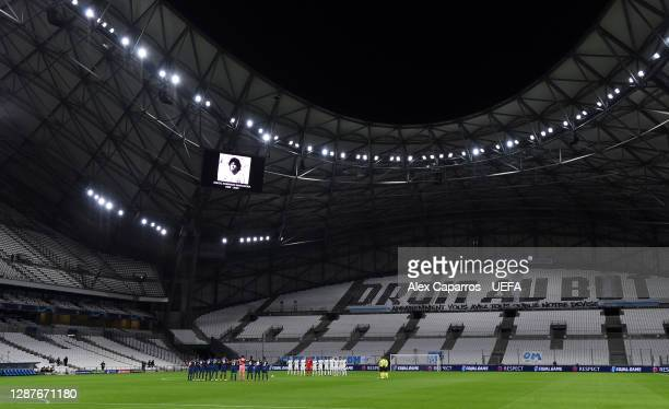 Players and officials take part in a minute of silence to remember Diego Maradona prior to the UEFA Champions League Group C stage match between...