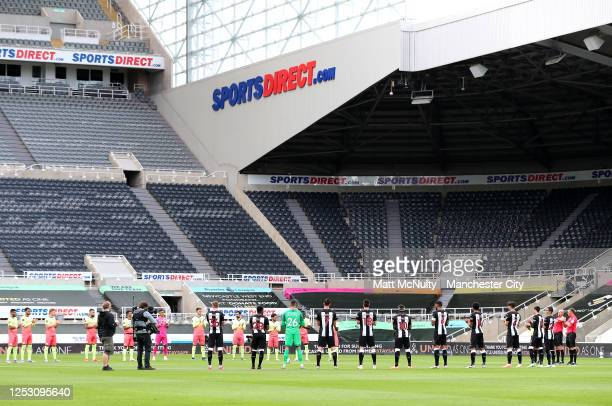 Players and officials take part in a minutes applause for the NHS during the FA Cup Quarter Final match between Newcastle United and Manchester City...