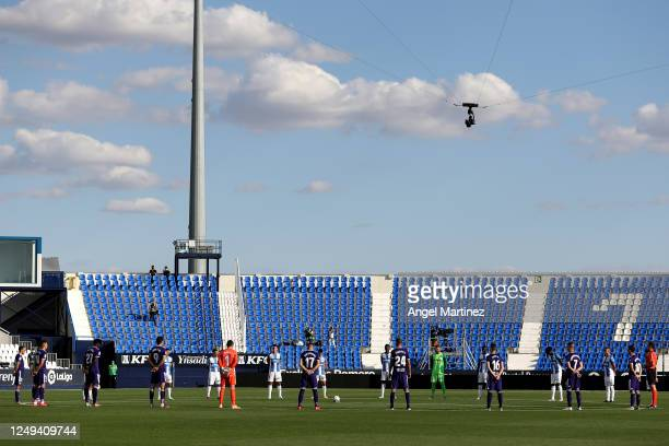 Players and officials take part in a minutes silence for those effected by Covid-19 during the Liga match between CD Leganes and Real Valladolid CF...