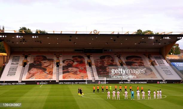 Players and officials take part in a minutes silence for those effected by the Coronavirus during the UEFA Europa League round of 16 second leg match...