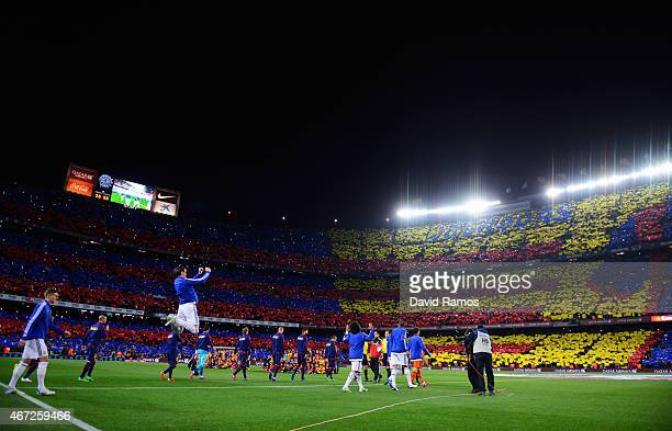 Players and officials walk onto the pitch prior to the La Liga match between FC Barcelona and Real Madrid CF at Camp Nou on March 22 2015 in...
