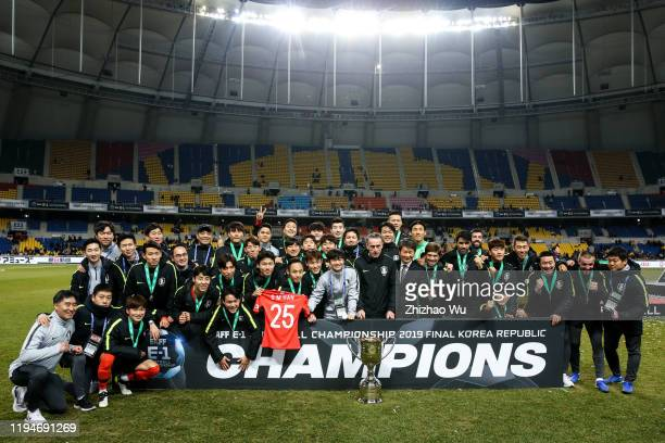 Players and Paulo Bento coach of South Korea celebrate the champion with trophy during the ceremony of the EAFF E-1 Football Championship match...