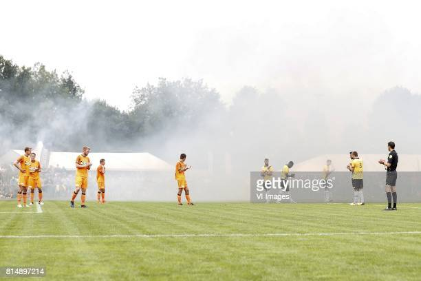 players and referee applaud for Abdelhak Nouri of Ajax during the friendly match between NAC Breda and FC Volendam at Sportpark Blankershove on July...