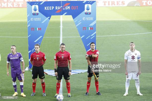 Players and referees are seen in front of a sign that reads Keep Racism Out during the Serie A match between ACF Fiorentina and Torino FC at Stadio...